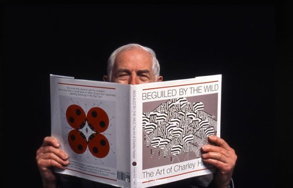 Charley Harper with his book, Beguiled by the Wild